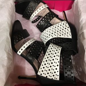 Vince Camuto black & white strapped heels.